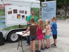 Learning about the different ingredients that make up soil at the Algona Public Library on June 11, 2013.