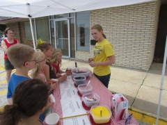 Creating some delicious edible soil at the Algona Public Library on  June 11, 2013.