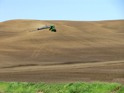 The increasing size of farm machinery is making it more difficult for row crop farmers to maneuver Iowa's hillier ground. This farmer in the Loess Hills is planting down the hill, instead of along the contour. There are also no visible conservation practices, such as residue management, terraces or grassed waterways to help reduce the risk of erosion.