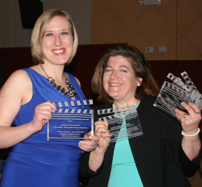 Ann Staudt and Jacqueline Comito show off a few of the Iowa Motion Picture Association Awards received by Water Rocks!