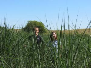 Ingrid and colleague standing in UI miscanthus plot near Iowa City.