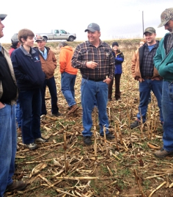 Mark Glawe speaking with attendees in the field. The clouds parted and the rain stopped just in time to go outside!