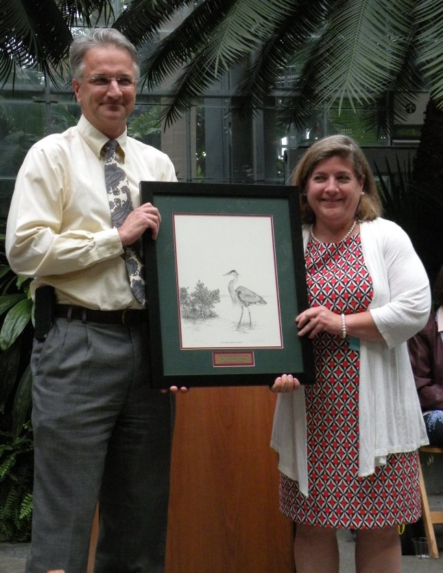 Comito is presented the 2015 National Wetlands Award for Education and Outreach from Jeff Williams, NRCS National Wetlands Specialist.