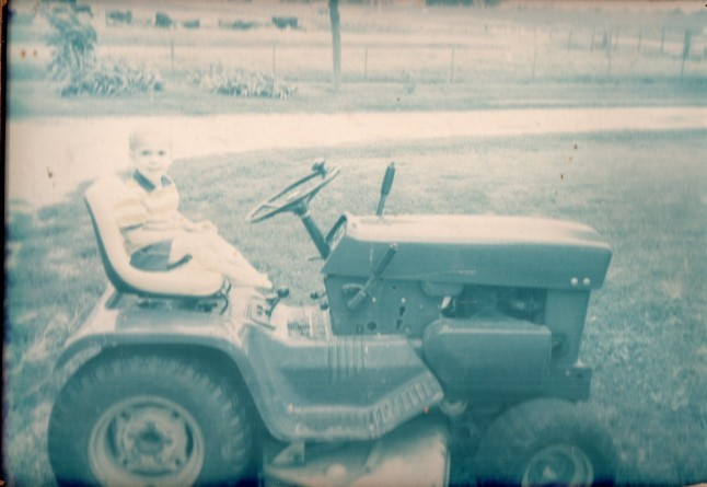 As you can see, my dad had me helping him on the farm before my feet could even reach the pedals!
