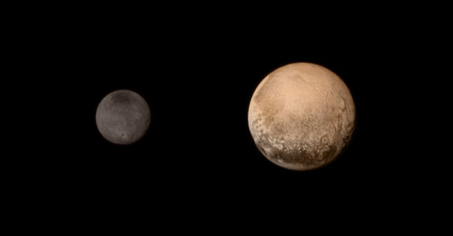 A composite image of Pluto, right, and its moonCharon/Image from NASA/JHUAPL/SWRI