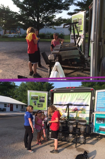 We invited one enthusiastic girl (in pink) to help teach the Rainfall Simulator (with the help of Ann) to her cousin, which she excitedly did at the Dallas County Fair.