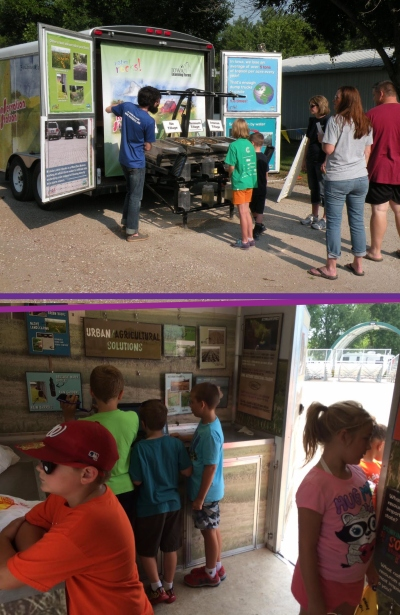Top: Brian Stout presents the rainfall simulator at the Dallas Co. Fair. Below: Kids checking out videos and posters in the Learning Lab, inside the Big Conservation Station trailer.