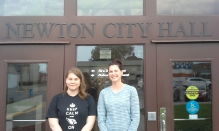 Student Emily Bollhoefer & Courtney Wolken in front of Newton City Hall, photo by Steve Hopkins